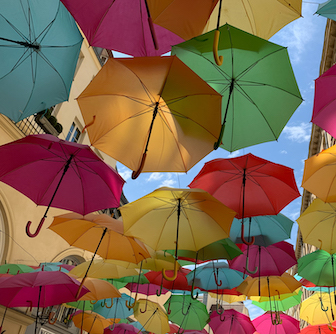 Brightly colored umbrellas floating in the air