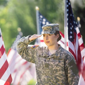 Female soldier saluting American flag