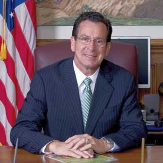 Governor Malloy sitting at his desk
