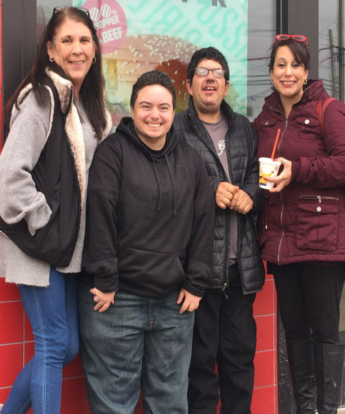 Doug Novitski and his friend Jamie Kennedy, with staff Elizabeth Diaz and Michelle Niemotko