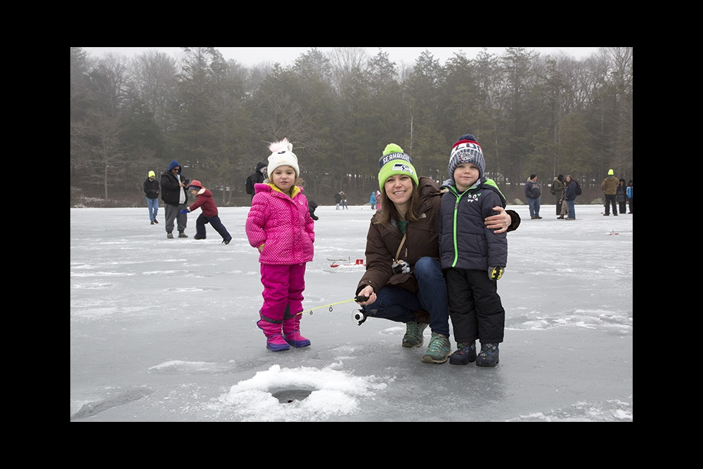 Family fishing at Burr Pond during the No Child Left Inside Winter Festival.