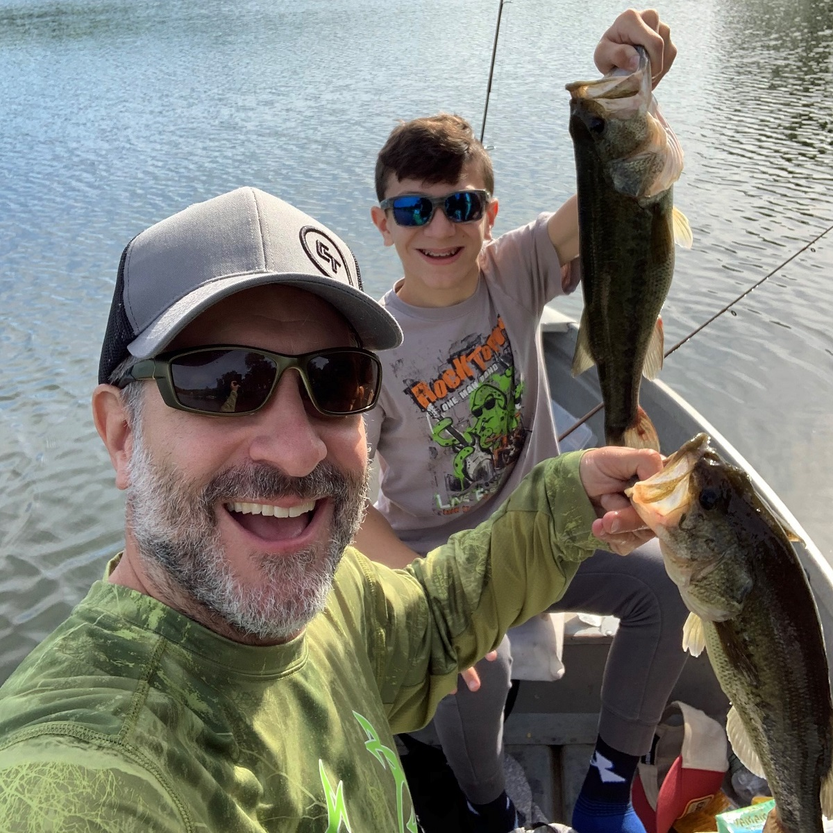 Fishing Guide Photo Contest winners with a largemouth bass double