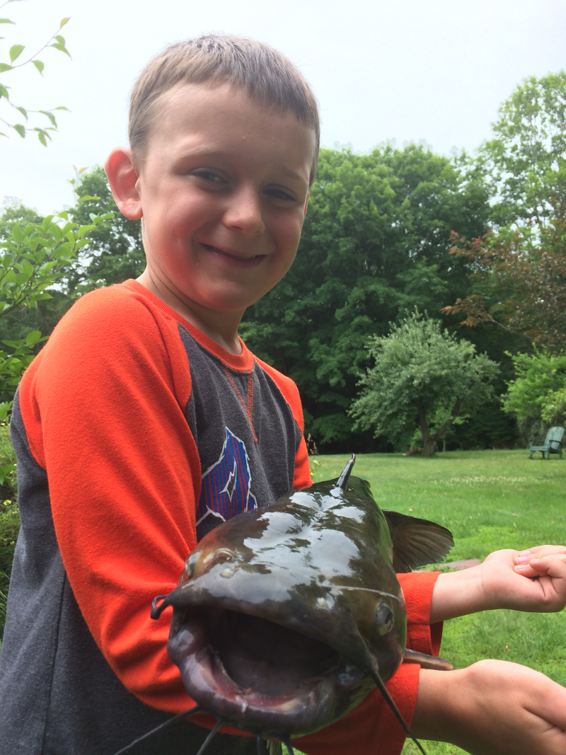 Boy with a large channel catfish.