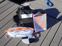 A secchi kit on a dock.