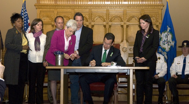 Governor Malloy signs into law a comprehensive bill on gun violence prevention, mental health initiatives, and school safety policies