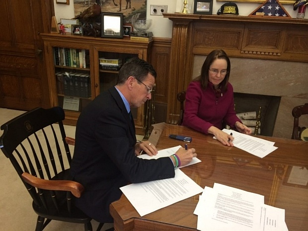 Governor Malloy, joined by Secretary of the State Denise Merrill, signs Executive Order No. 45 banning state-funded travel to states that have enacted legislation to protect religious freedom but do not prohibit discrimination for classes of citizens. The order was written in response to recent developments in Indiana. (March 30, 2015)