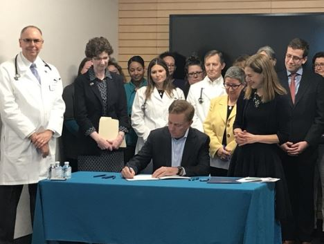 Governor Lamont signing healthcare benchmark executive order