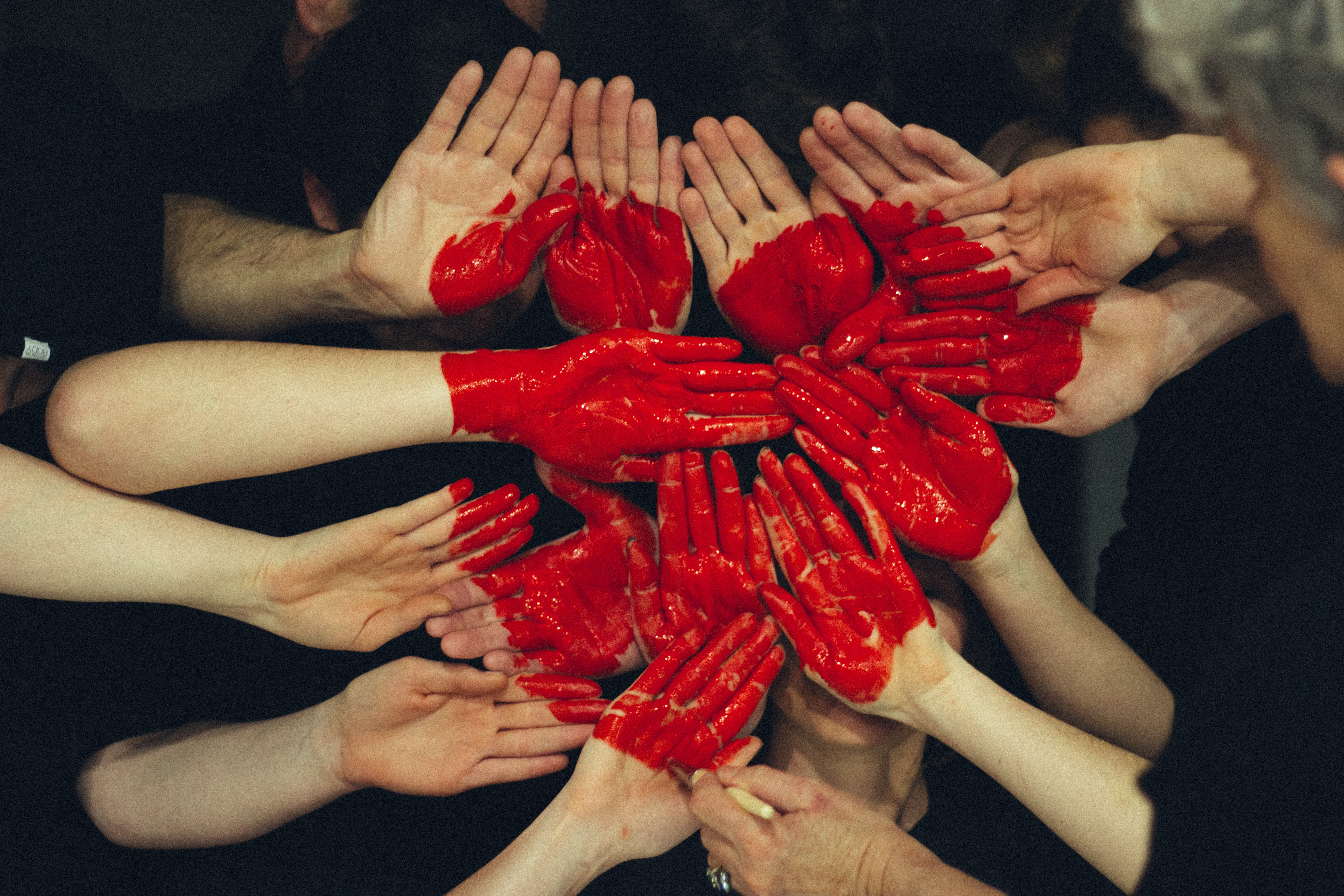 joined hands with red painted heart