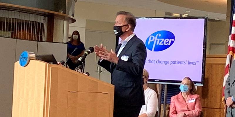 Governor Lamont speaking at a podium at Pfizer in Groton