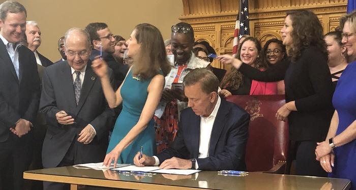 Governor Lamont signing FMLA bill
