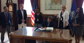 Governor Lamont signing the state budget