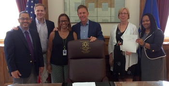 Governor Lamont signing the budget
