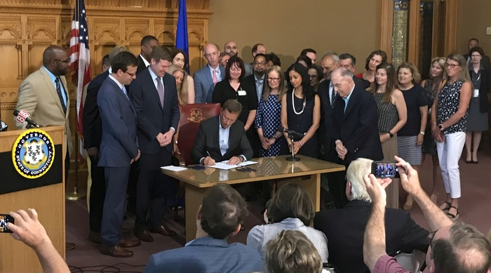 Governor Lamont signing the Mental Health Parity Act