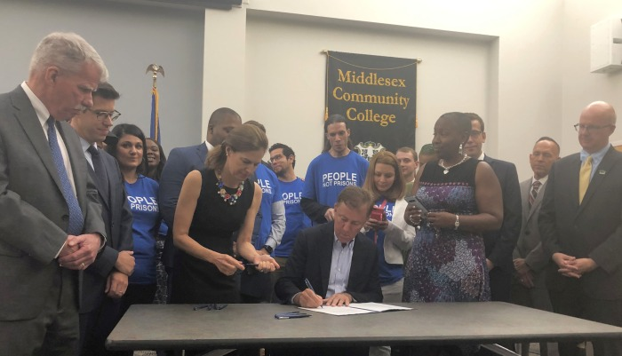 Governor Lamont signing bill