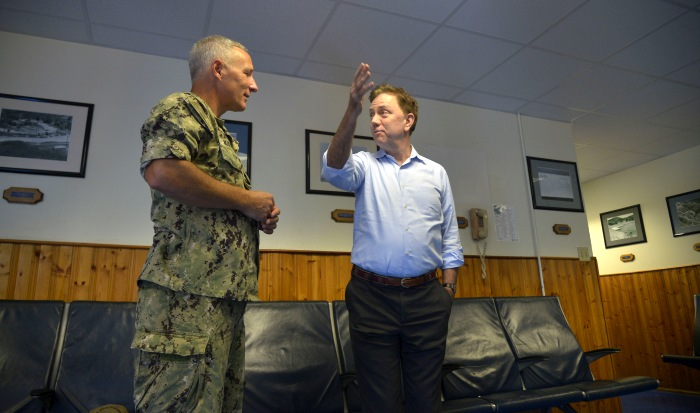 GUANTANAMO BAY, Cuba (Dec. 27, 2019) Rear Adm. Timothy Kuehhas, Joint Task Force commander at Naval Station Guantanamo Bay (NSGB), left, speaks with Governor Ned Lamont. NSGB is the forward, ready, and irreplaceable sea power platform in the Caribbean, and has supported the Navy's most advanced ships for more than a century. (Credit: U.S. Navy photo by Mass Communication Specialist 2nd Class Kevin J. Steinberg/RELEASED)
