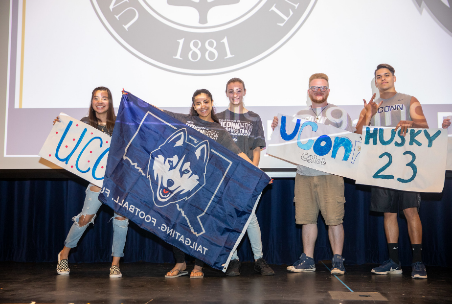 Students holding UConn banners