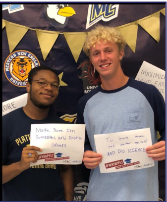 two students holding written goals