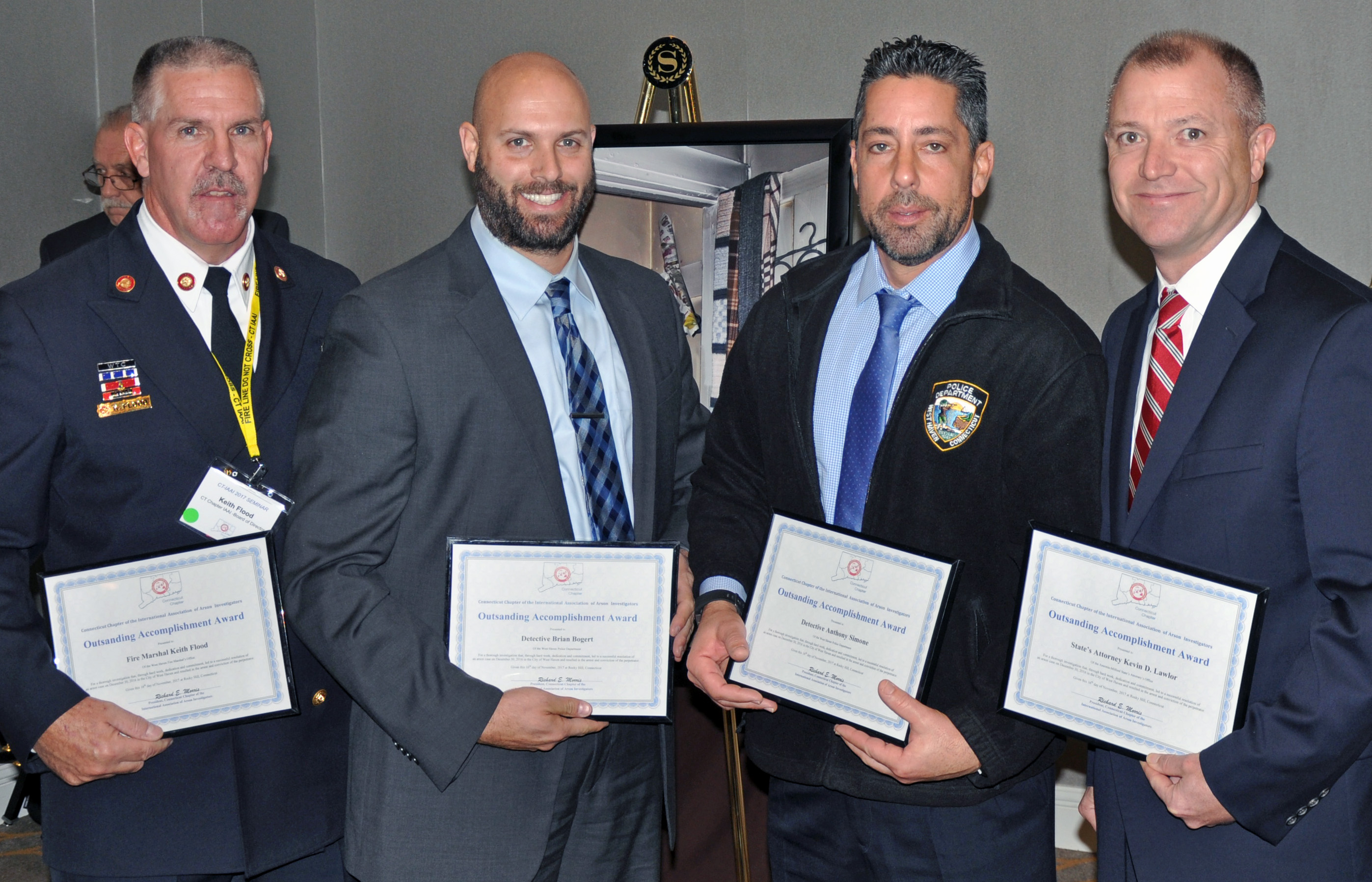 State's Attorney Kevin Lawlor (right) was honored by the International Association of Arson Investigators.