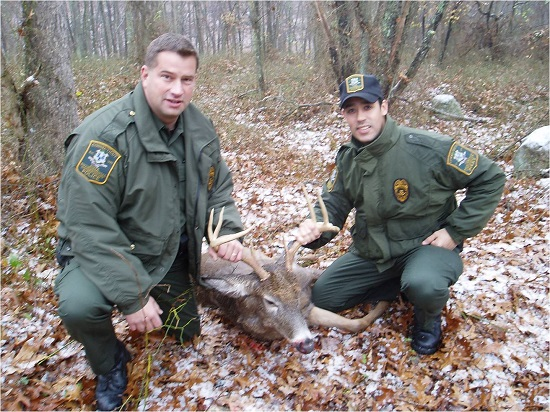 EnCon Police Officers with a deer