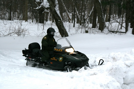 EnCon Officer on snowmobile