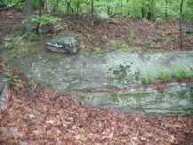 Photograph of Well-exposed outcrop of the Rowe Schist near the Revolutionary War Memorial