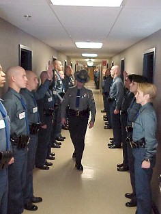 Recruits standing at attention during an inspection
