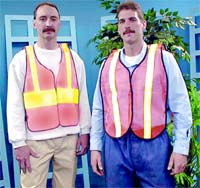 Two men post safety vest