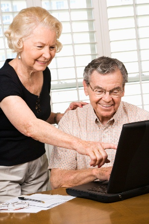 Elderly couple looking at computer