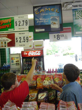 kids looking at cigarette ads in store