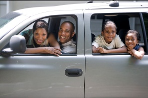 family in car