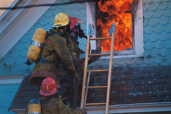fighter fighter on ladder at house fire