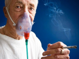 man with oxygen and cigarette