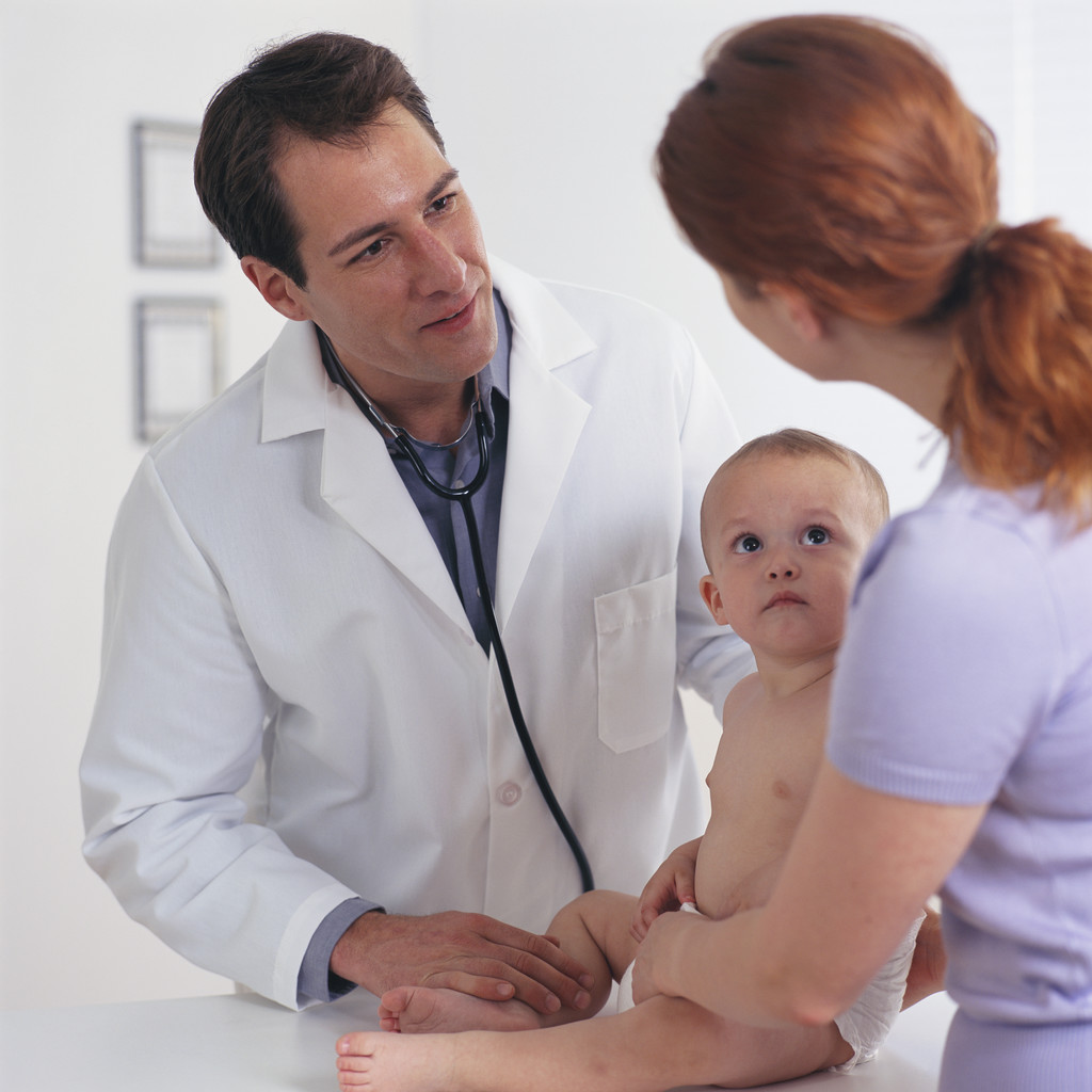 Doctor talking to parent with child