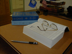 Photo of open statute book on desk
