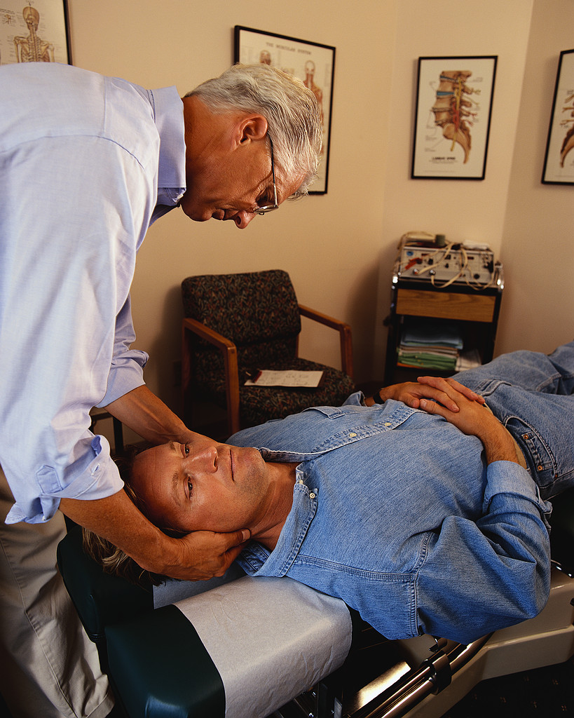 Doctor of Chiropractic with patient