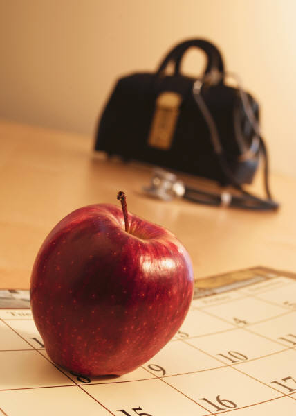 Doctors bag and apple