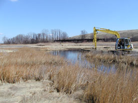Equipment excavating ponds and channels