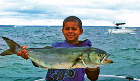 Image of Boy with Bluefish