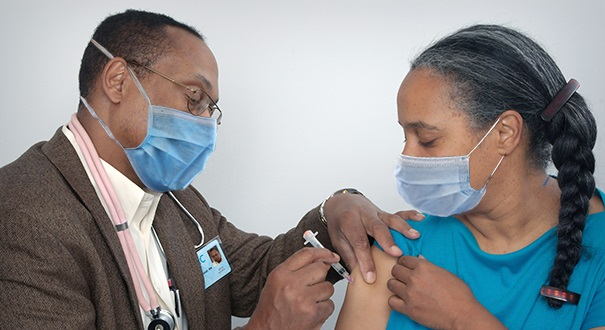 Individual getting a vaccine shot